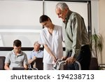 senior man being assisted by... | Shutterstock . vector #194238713
