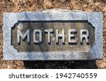 Mother Carved In The Top Of A...