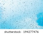Water Drops Of Rain On Blue...
