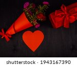 A Bouquet Of Flowers In Red...
