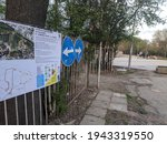 Small photo of Sofia, Bulgaria - Apr 28 2020: Walking in the park was made one-directional to limit the number of infected with corona virus. An explanatory scheme for walking at the park entrance.
