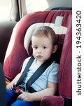 adorable baby boy in safety car ... | Shutterstock . vector #194363420