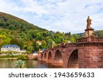 The Alte Brucke (old bridge) is an arch bridge in Heidelberg that crosses the Neckar river.