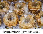 Small photo of Traditional sweet pastry in a bakery, each piece individually wrapped in cellophane