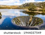 Covao Dos Conchos - A hole in the middle of the Lake in Serra da Estrela. Bell mouth spillway