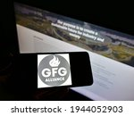 Small photo of Stuttgart, Germany - 03-09-2021: Person holding mobile phone with business logo of Gupta Family Group Alliance (GFG Alliance) on screen in front of webpage. Focus on phone display. Unmodified photo.