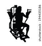 Man Exercising On Gym Machine...