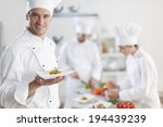 chef presenting a dish with his ... | Shutterstock . vector #194439239