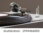 An old antique turntable with melodies - gramophone. Vintage record player spins.