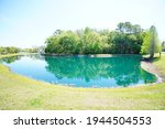 A Small Pond And Geyser In A...