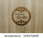 premium quality on wood texture. | Shutterstock . vector #194470409