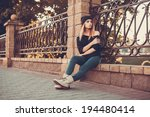 Young Girl Posing In The City