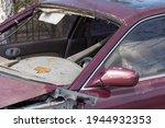 An Old Car At A Junkyard....