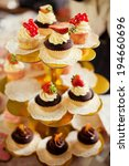 stand of different cupcakes... | Shutterstock . vector #194660696