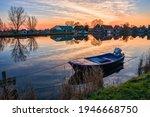 Boat On Lake Water At Dawn...