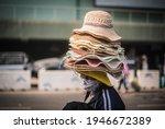 A Female Street Vendor Walks...