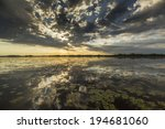 ominous stormy sky reflection... | Shutterstock . vector #194681060