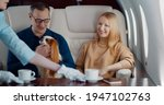 Air Hostess Serving Coffee For...