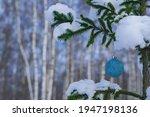 A Shiny Blue Ball Hangs On A...
