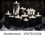 group of black burning candles...   Shutterstock . vector #1947311236