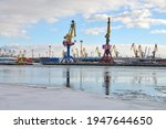 Moored Cargo Ships And Harbor...
