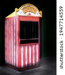 Small photo of Old ticket booth at a carnival or circus selling ticket for rides and fun