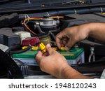 Man Hand Checking Car Battery...