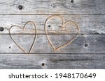 Two Hearts Carved In Wood As A...