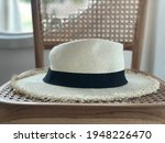white panama hat on table   Shutterstock . vector #1948226470