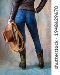 female legs in leather cowboy... | Shutterstock . vector #1948629670