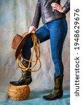 female legs in leather cowboy... | Shutterstock . vector #1948629676