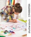 seamstress working in studio | Shutterstock . vector #194888984