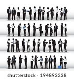Silhouettes Of Business People...