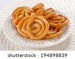 sweet   hot jalebi in beautiful ...   Shutterstock . vector #194898839