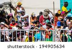 Small photo of Barranquilla, Colombia - March 1, 2014 - Spectators watch the Battalia de Flores parade during the Carnival de Barranquilla.