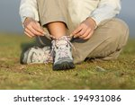 hiker woman tying shoelaces of... | Shutterstock . vector #194931086