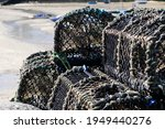Stacked Lobster Pots On A Pier...