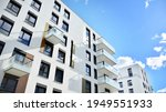 Multistoried modern, new and stylish living block of flats. Newly built apartment building.