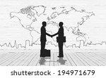 Two Business Man Shake Hand...