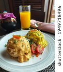 Small photo of Tom Yum Eggs Benedict and Chicken Curry Eggs Benedict