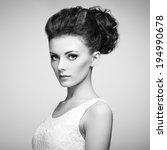 Portrait of beautiful sensual woman with elegant hairstyle.  Perfect makeup. Fashion photo - stock photo