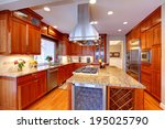 Stock photo luxuriant kitchen interior view of storage combination kitchen island and appliances 195025790