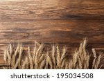 Wheat On Wooden Background. To...
