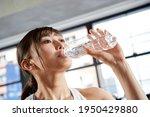 Asian Women Drinking Water...