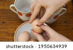 Fingers Try To Open Eggshell Of ...