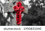 A Wreath Of Poppies Hung On A...