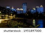 Haikou scenic nightscape with promenade along coastline and illuminated skyline at night in Haikou Hainan China