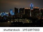 Haikou city skyline with sea and shoreline illuminated at night in Haikou Hainan China