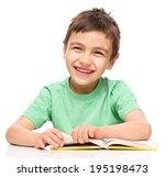 Cute Little Boy Is Reading A...