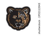 colored face of a bear. samoan... | Shutterstock .eps vector #1952112043